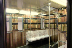 A subway carriage has been decorated to look like a library