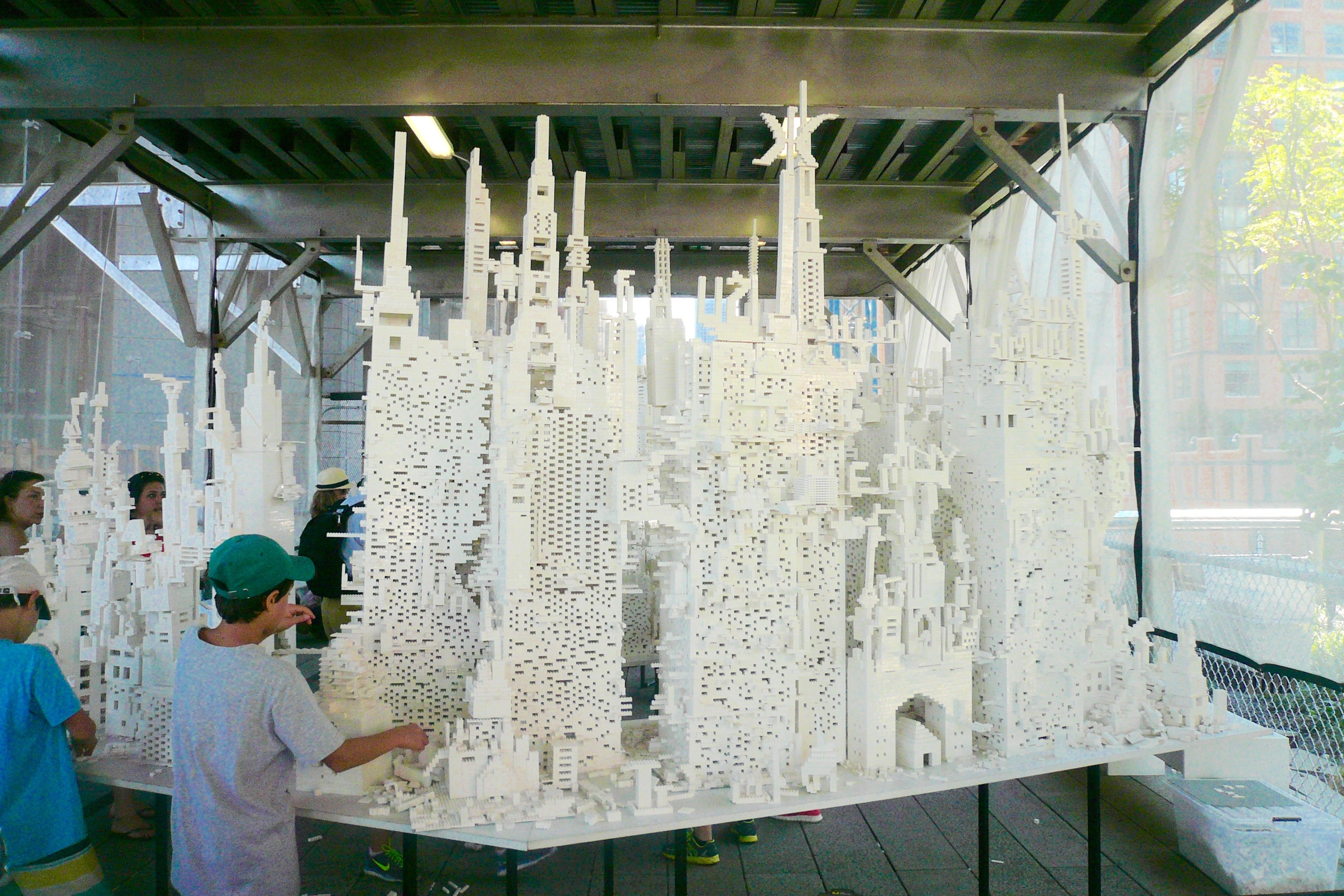 Visitors of the High Line Park build an imaginary city with Legos