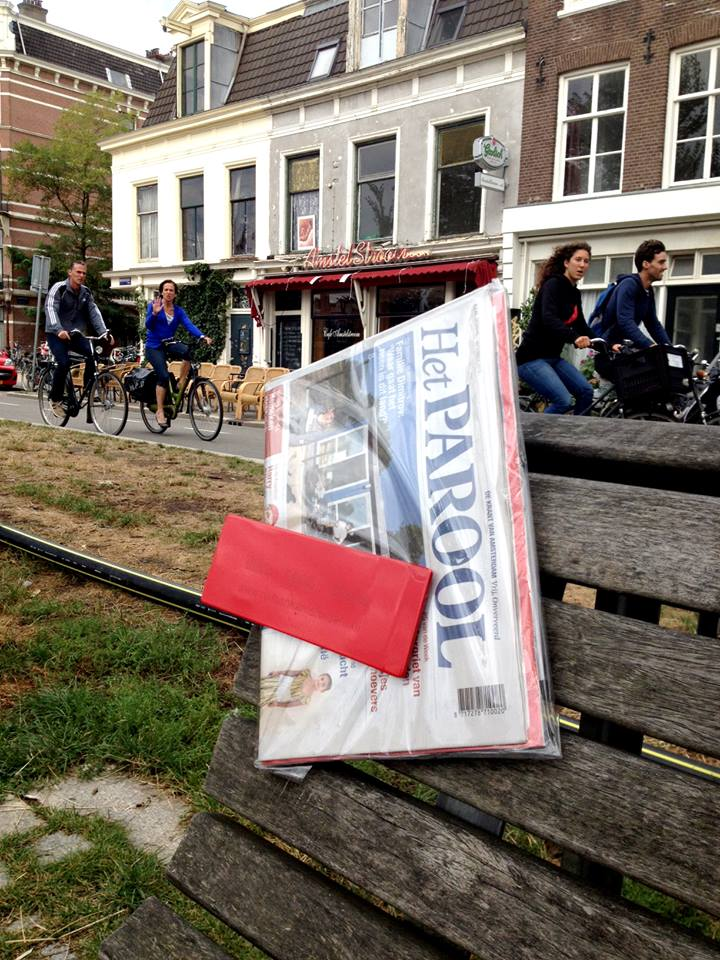 Ruilbank_Morning newspaper at public benches Amsterdam