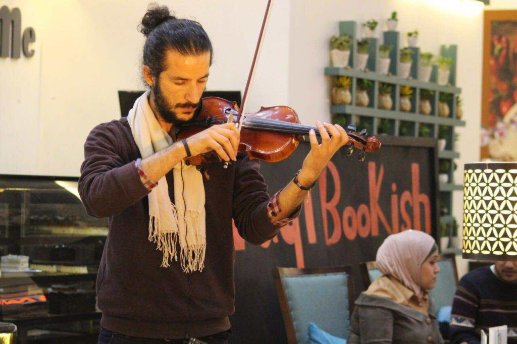 Playing music at the reading club Iraqi Bookish in Baghdad