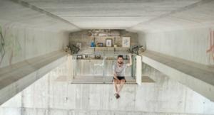 A hidden workspace under a concrete bridge