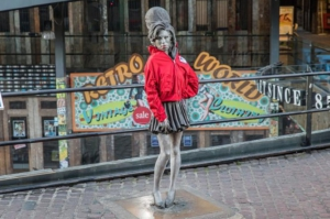 Statues wrapped in red coats to encourage coat donations