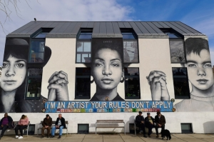 Female street art praises women's achievements at public space